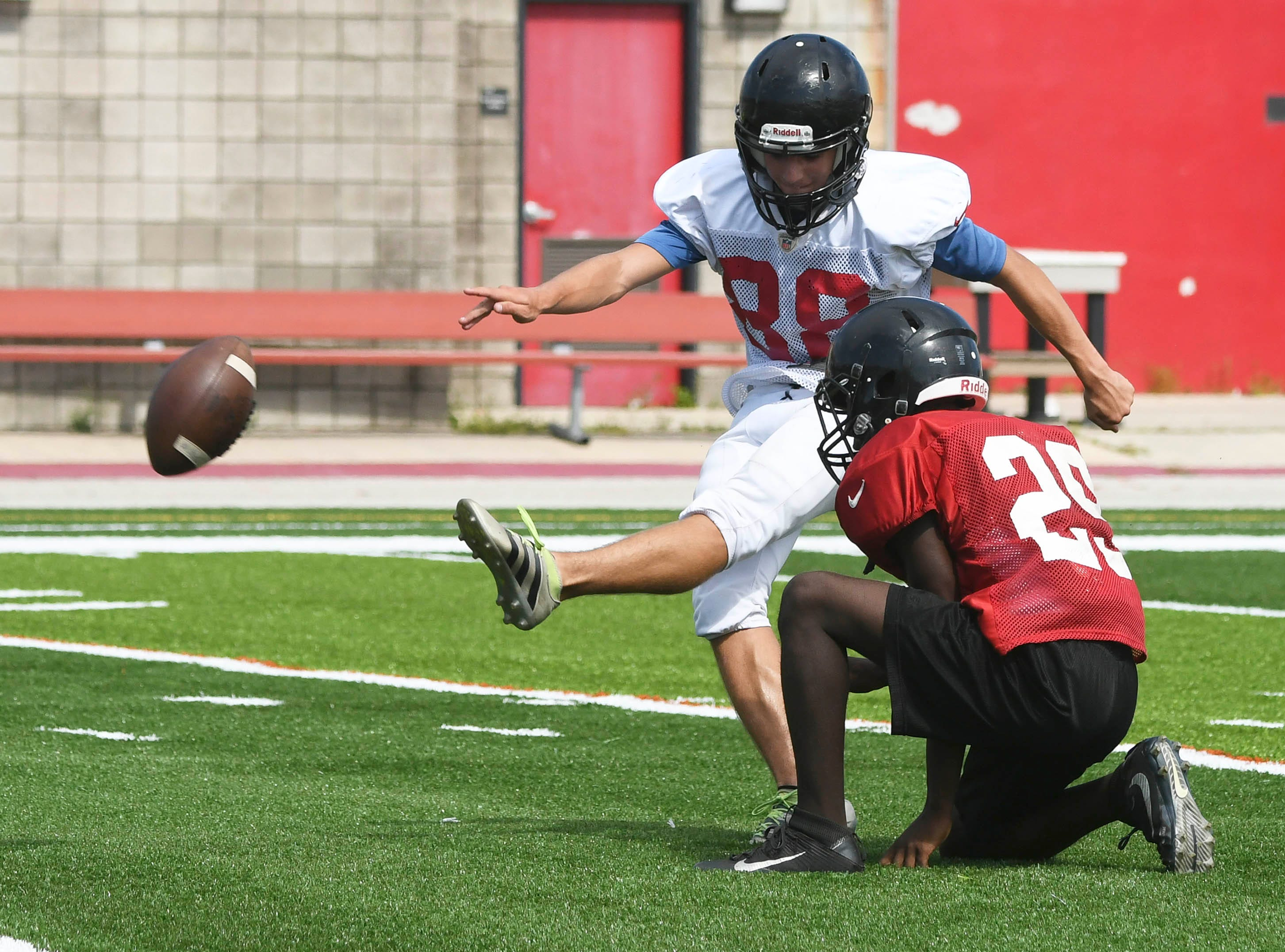 Players at Palm Bay Magnet High run through drills during practice Tuesday afternoon