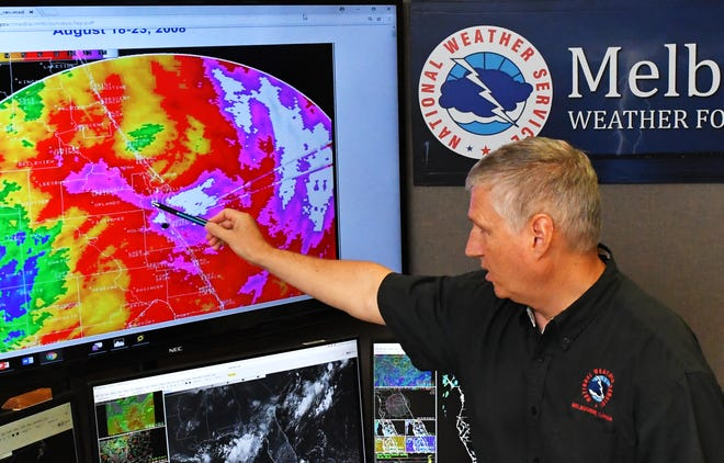 Scott Spratt, warning coordination meteorologist at the National Weather Service station in Melbourne, recalls the record rain levels of Tropical Storm Fay in 2008.