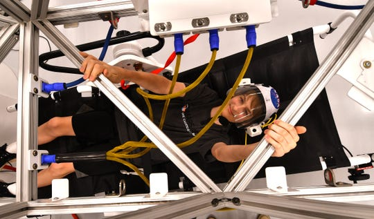 Jaedon Hight, who attends Stone Magnet School and is in the Astronaut Club, gets a taste of micro gravity in the simulator. The Astronaut Training Experience at the Kennedy Space Center Visitor Complex had its grand opening Thursday morning. The attraction lets you train like the next generation of astronauts and  explorers going to Mars.