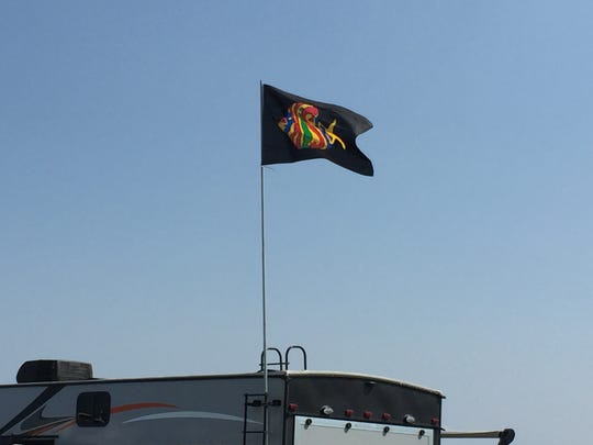 A Phish flag flies atop an RV on Aug. 16, 2018, at a campground in Watkins Glen, N.Y., site of Phish's Curveball festival.