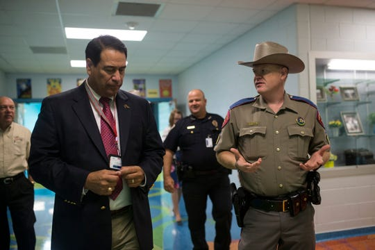CCISD superintendent Dr. Roland Hernandez (left) and DPS trooper sgt. Nathan Brandley discuss new community partnership between CCISD police department and local Department of Public Safety troopers on Thursday, August 16, 2018 at Dr. J.A. Garcia Elementary School.