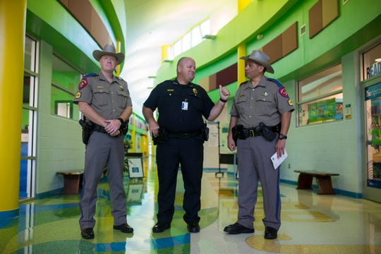 DPS trooper's sgt. Rodney Hernandez (right) and sgt. Nathan Brandley talk with  CCISD police chief Kirby Warnke before they announce the new community partnership between CCISD police department and local Department of Public Safety troopers on Thursday, August 16, 2018 at Dr. J.A. Garcia Elementary School.