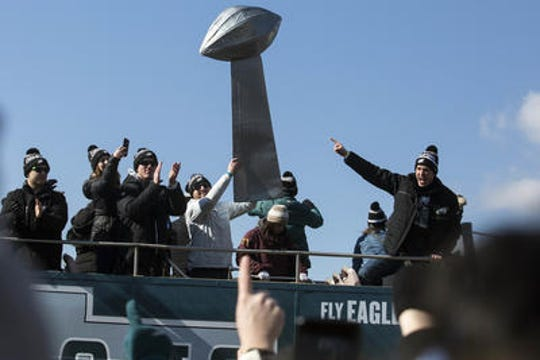 Eagles players and fans celebrate the team's first Super Bowl championship with a parade up Broad Street to the Philadelphia Art Museum just days after the Feb 4, 2018, victory.