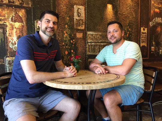 Christian Rattel and Jason Hind, owners of Cafe Flora in Cherry Hill, sit in their cafe, which shares space with their floral shop, Jacqueline's Flowers and Gifts.