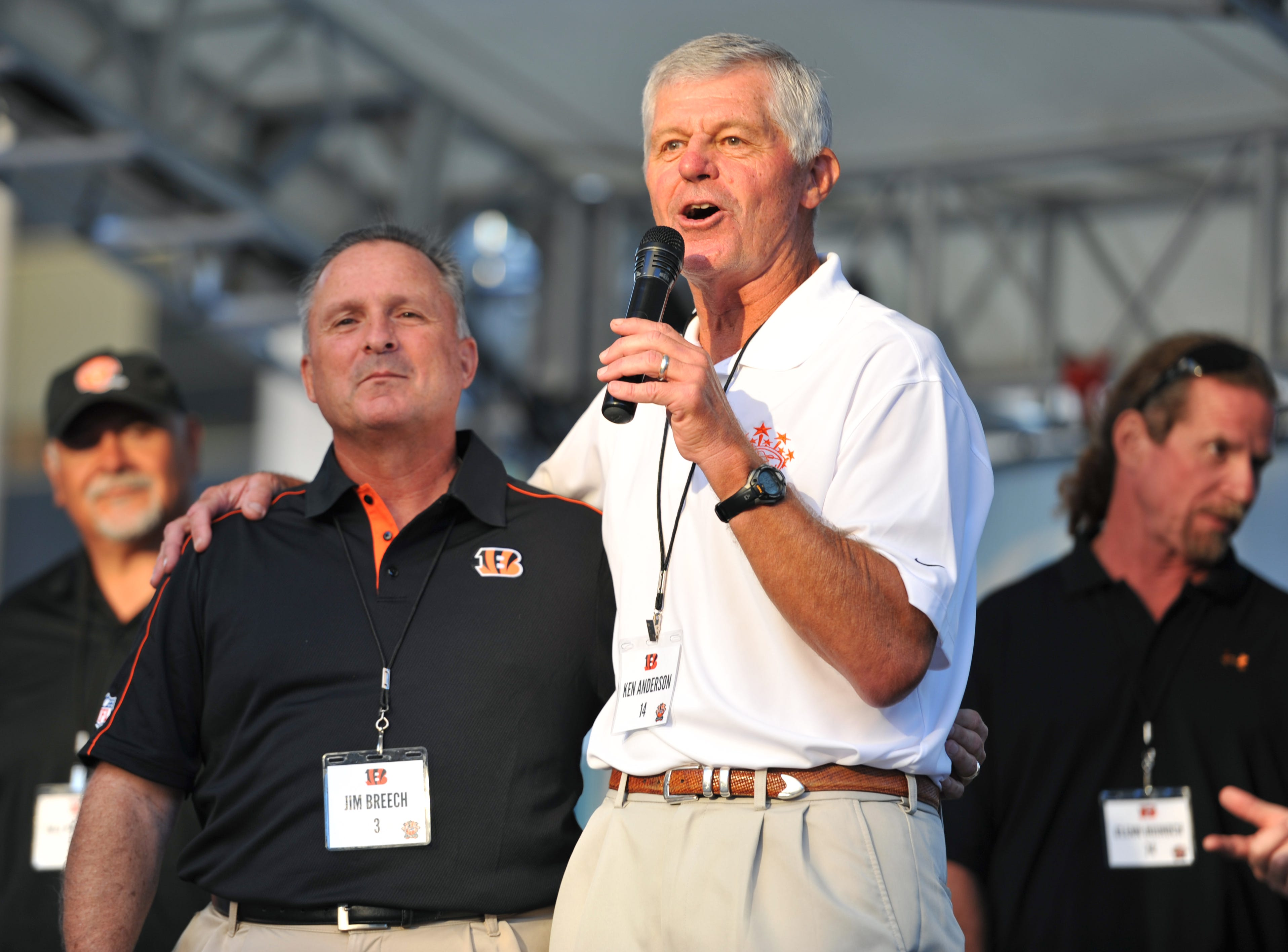 Ken Anderson, right, and Jim Breech, left, thank everyone for coming out to Fountain Square during the Ken Anderson Tailgate to benefit IMPACT Autism on Sept. 10, 2012.