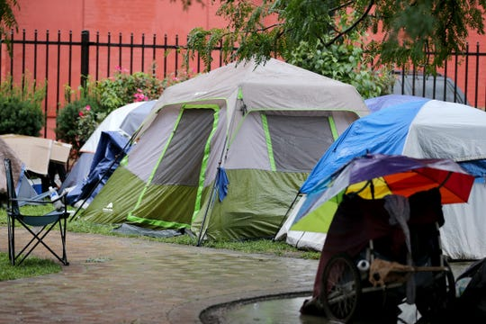 A homeless camp at the corner of 13th and Republic Streets in Over-the-Rhine in August of 2018. Council members grappled with how to solve the problem, but later a judge would determine the camps were illegal.