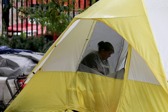 The deadline to clear Cincinnati's homeless camp at the corner of 13th and Republic Streets in Over-the-Rhine was extended, Thursday, Aug. 16, 2018.  City officials scrapped the previous deadline of noon Thursday so people in the camp would have more time to find housing or shelters.