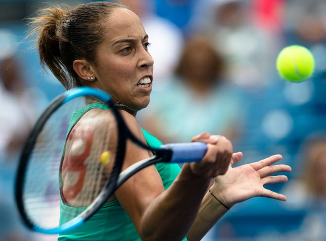 Madison Keys returns to Angelique Kerber during their match at the Western & Southern Open at the Lindner Family Tennis Center in Mason, Ohio, on Thursday, Aug. 16, 2018.