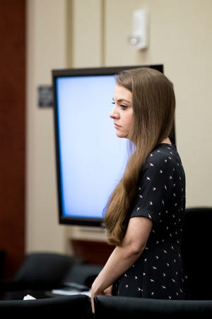 Shayna Hubers, 27, stands during a break on the third day of testimony at her second murder trial.