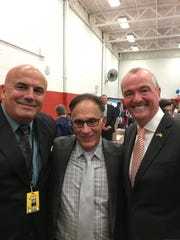 Monroe Township Acting Superintendent of Schools Robert Goodall and Steven Riback, school board vice-president, were among those that  attended Gov. Phil Murphy's signing of  school funding legislation in July.