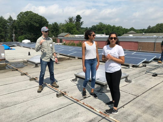 Checking out the solar array on the school's rooftop was among the favorite parts of the summer internship.