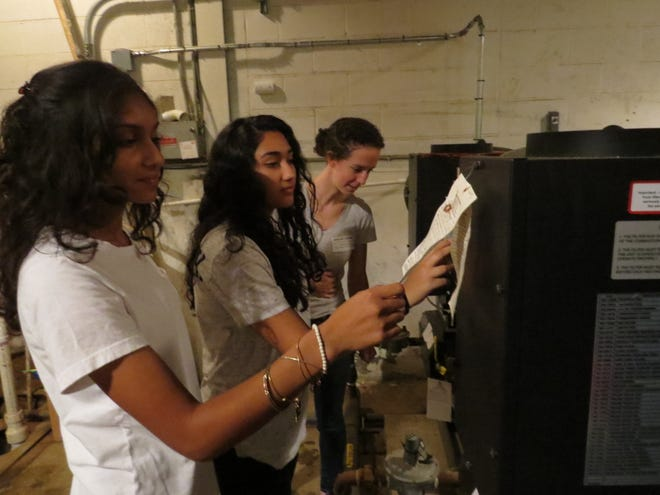 Lara Jasti and Dazlyn Erachshaw investigate the boiler room with Stonehouse Group associate Terry Duncan.