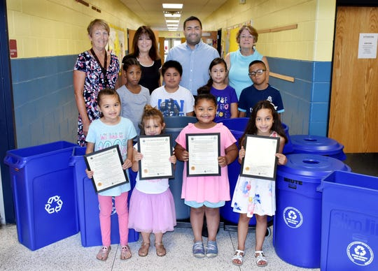 Union County Freeholder Chairman Sergio Granados speaks with students and Rahway Superintendent of Schools Dr. Patricia Camp, Program Supervisor of Alternative Education JoAnn Mannix and Union County Bureau Chief of Recycling & Planning JoAnn Gemenden about new recycling bins for schools at Franklin Elementary School in Rahway. A free distribution program administered by Union County and funded by the New Jersey Department of Environmental Protection has provided recycling bins to 56 schools in nine municipalities.