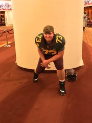 Josh Volk poses for a photo during an unofficial visit to Minnesota.