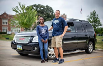 Roosevelt teacher Brandon Hope helped out graduate Anyesi Kamanda b y gifting her his father's 15 year old vehicle