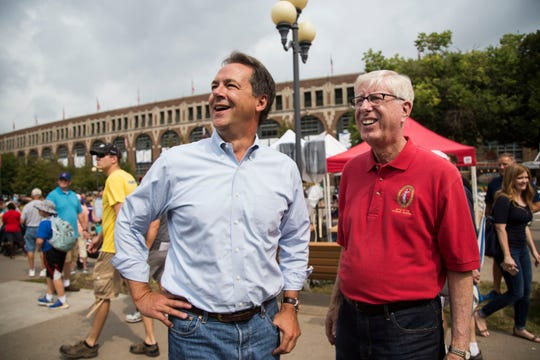 Steve Bullock, governor of Montana, stands just off the Grand Concourse of the Iowa State Fair with Iowa Attorney General Tim Miller before speaking at the Des Moines Register Political Soapbox on Thursday, Aug. 16, 2018, at the State Fair.