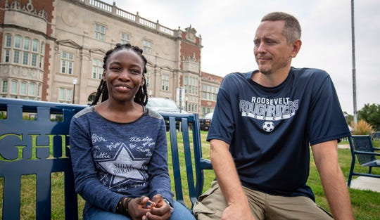Roosevelt graduate Anyesi Kamanda and soccer coach Brandon Hope talk outside Roosevelt High School on Thursday. Kamanda is leaving for Kirkwood Community College in Cedar Rapids on Friday in the vehicle her coach gave her.