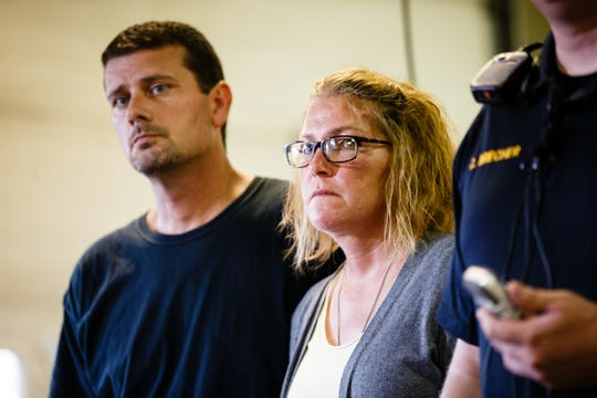 """Jake's mother Megan Neiswonger and stepfather Jeremy Neiswonger listen as La Porte City Police Chief Chris Brecher speaks to the press about updates in the case of Jake Wilson on Thursday, Aug. 16, 2018 in La Porte City. Brecher said remains had been found that were """"consistent with what they had been looking for"""" in Wolf Creek. Wilson went missing in April after going for a walk."""
