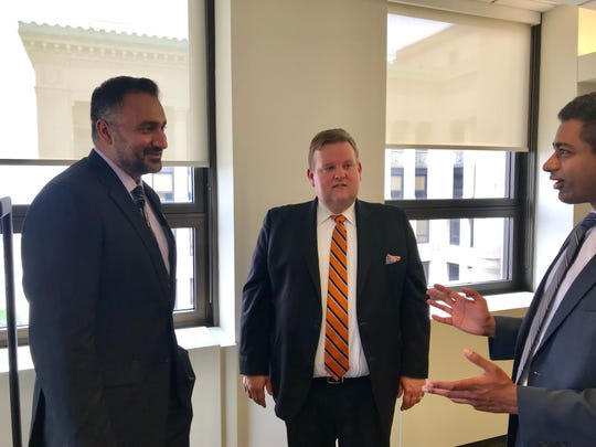 Attorneys (left to right) Hassan Ahmad, Phil Ellison, Humza Kazmi, outside courtroom at Michigan Court of Appeals in Detroit. They're battling to get sealed papers of Dr. John Tanton from University of Michigan.