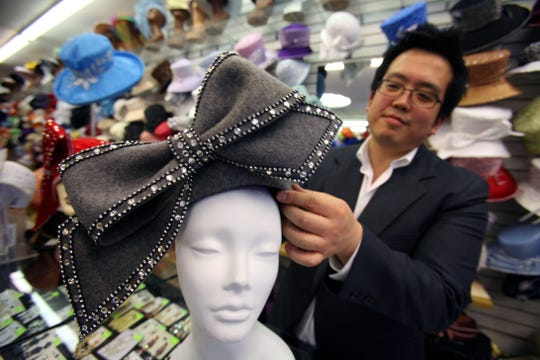 """Luke Song, 36, designed the hat that Aretha Franklin wore while singing Samuel F. Smith's """"My Country 'Tis of Thee"""" during  Barack Obama's inauguration as the 44th President of the United States. The $179 hat, customized with Swarovski crystals, came from Mr. Song Millinery in Detroit seen here on January 21, 2009."""
