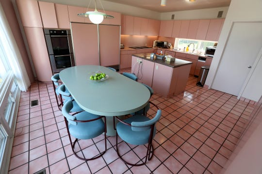 "Tile, cabinets and most appliances are all pink in the kitchen. ""I enjoy the pink because it's warm,"" the owner said. ""Especially on a sunny day."""