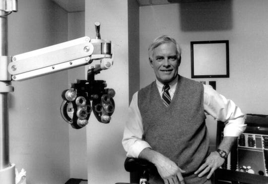 """Dr. John Tanton, an ophthalmologist, in his Petoskey office in February 1989.  From the story, """"has been beseeching the nation for years to make English its official language before it's too late, and to zip up its borders before the tide of illegal immigrants turns into a torrent."""""""