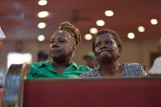 Emma Lockridge, right, of Detroit and the Rev. Leslie Mathews of Detroit Triumphant Life Christian Church sit in a pew while gathered Thursday, August 16, 2018, at New Bethel Baptist Church in Detroit, the church  Aretha Franklin grew up attending.