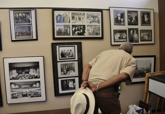 Silvester Porter, of Detroit, looks over old photos in the history room of New Bethel Baptist Church in Detroit while visiting the church where Aretha Franklin grew up attending in Detroit on Thursday, August 16, 2018.