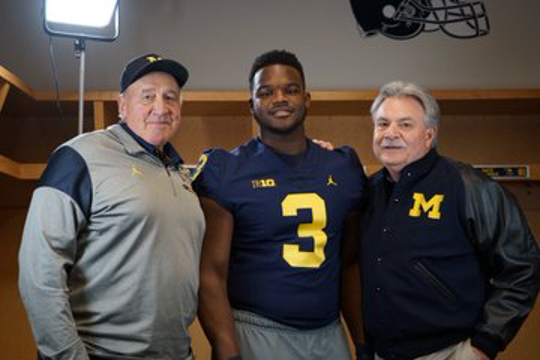 Mazi Smith, of East Kentwood, with Michigan defensive coordinator Don Brown, right.