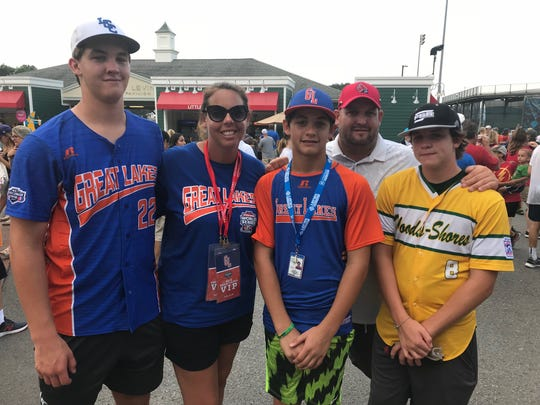 The Hill family of Grosse Point Little League stand outside of Lamade Stadium on the opening day of the Little League World Series in Williamsport. Tyler, Lindsay, Brennan, Jason, and Drew Hill are plenty family with the area. Tyler and Drew played in prior years and Brennan will make his Series debut Friday.