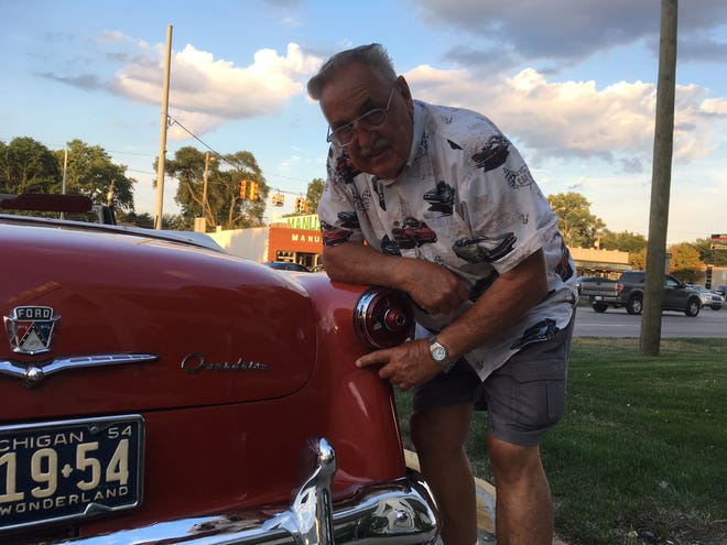 Bill Haas of South Lyon was rear-ended 15 years ago as he was driving his 1954 Ford Sunliner convertible to be displayed at the Glass House in Dearborn. The filler from the repair is beginning to crack.