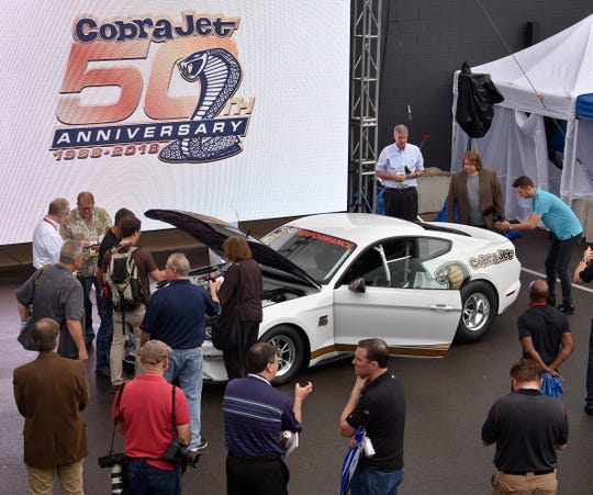 Ford Performance unveils their 50th Anniversary edition of the legendary Mustang Cobra Jet outside their Woodward Dream Cruise Clubhouse at the Kruse and Muer restaurant on Woodward Avenue Thursday morning, August 16, 2018.