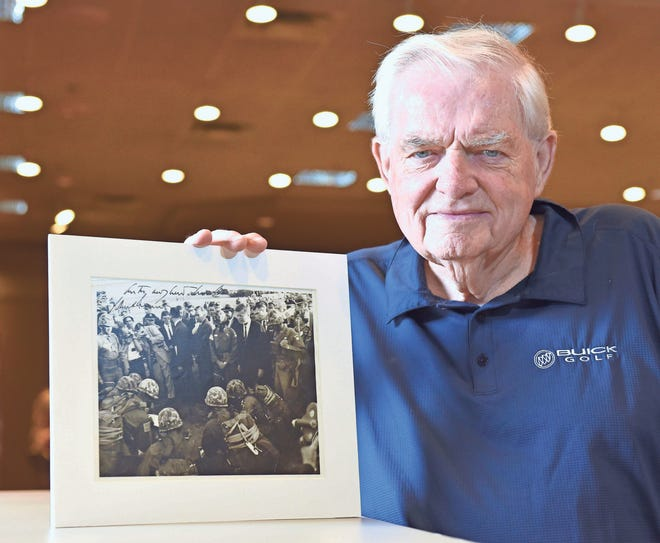 Gerald Ruckert of Southfield poses with an autographed image of President John K. Kennedy from 1962 when the President visited Fort Bragg, North Carolina.