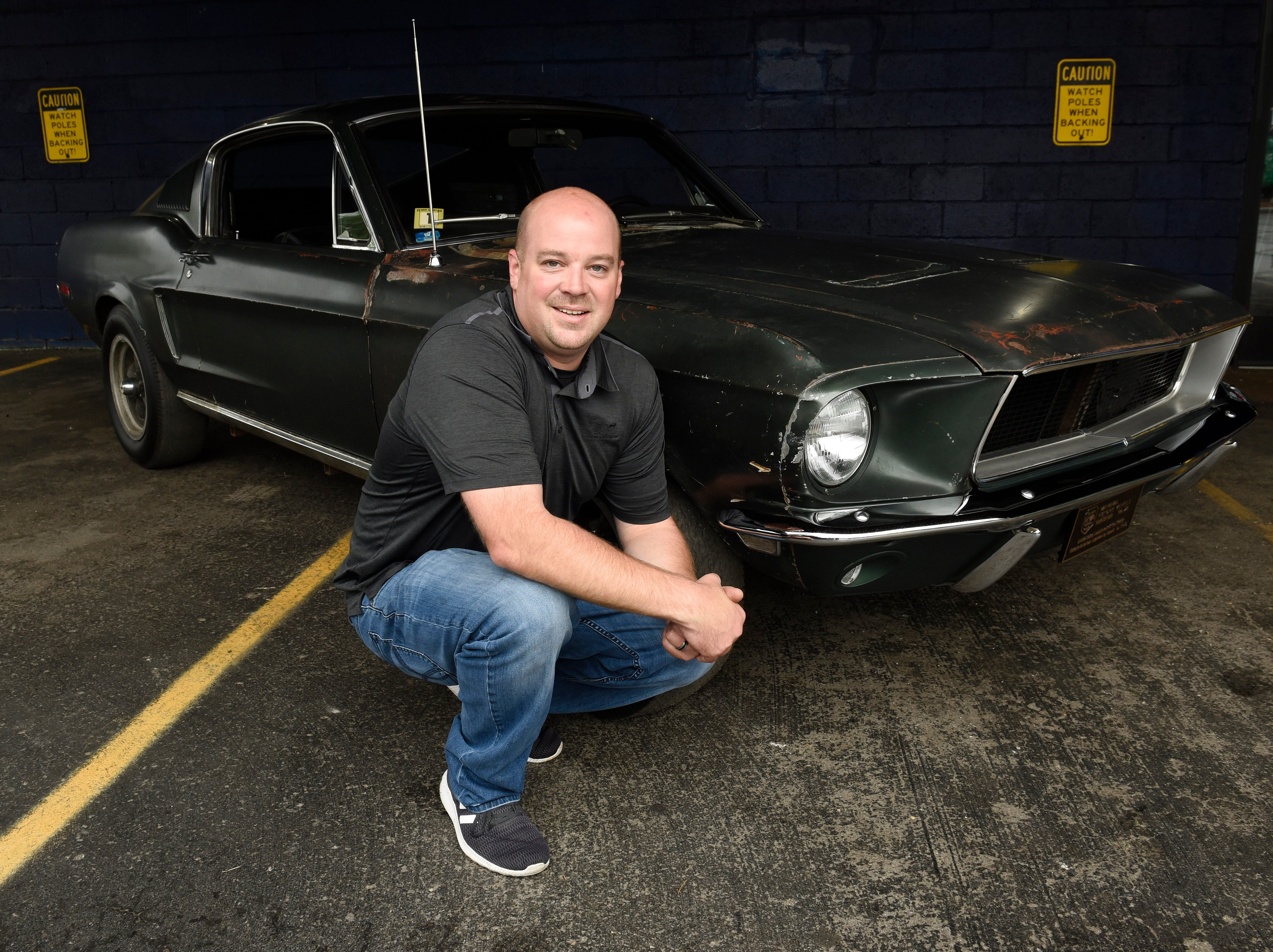 "Sean Kiernan poses in front of his 1968 Mustang GT Fastback, the original car driven by Steve McQueen in the movie ""Bullitt."" Kiernan said he's happy to have another chance to let fans see the pony car at the Woodward Dream Cruise."