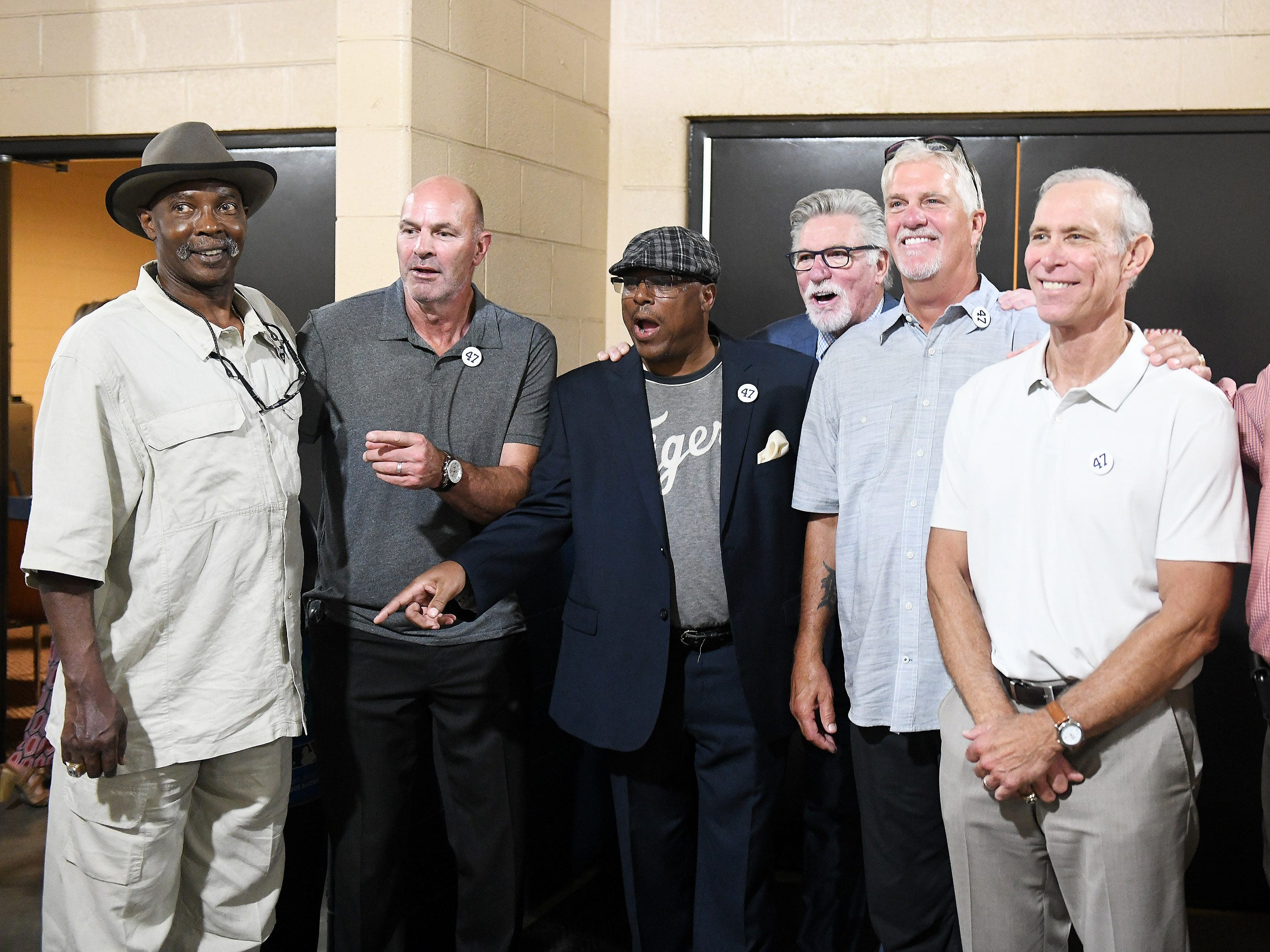 Members of the 1984 Tigers World Series Championship team react when they see former trainer Pio DiSalvo, not shown, while they gather before the special pregame ceremony to retire the #47 of former Tigers pitcher and Hall of Fame pitcher Jack Morris. From left, Larry Herndon, Kirk Gibson, Lou Whitaker, Jack Morris, Dave Rozema, Alan Trammell and Dan Petry.