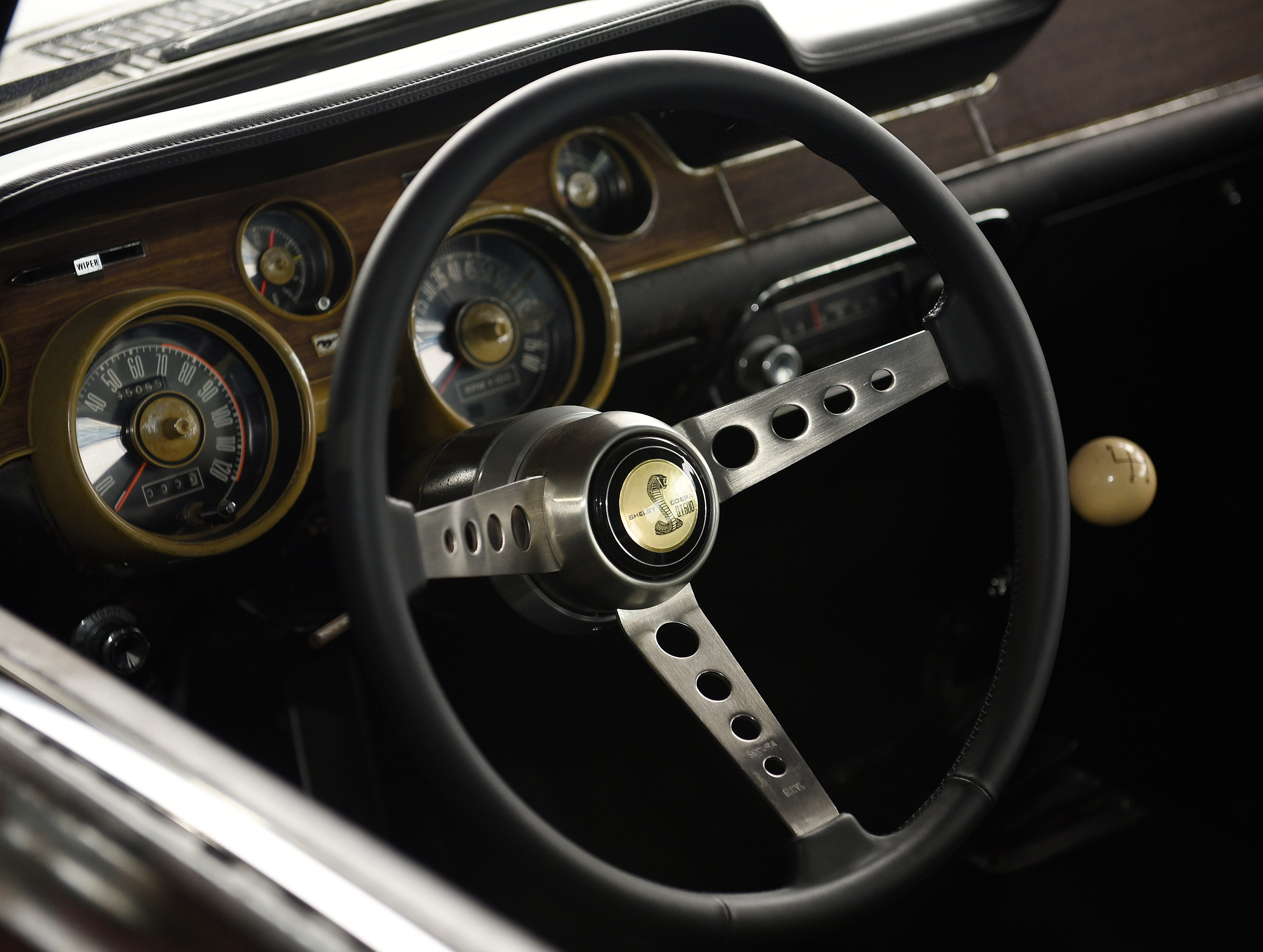 The dash and steering wheel of the original 1968 Mustang GT Fastback