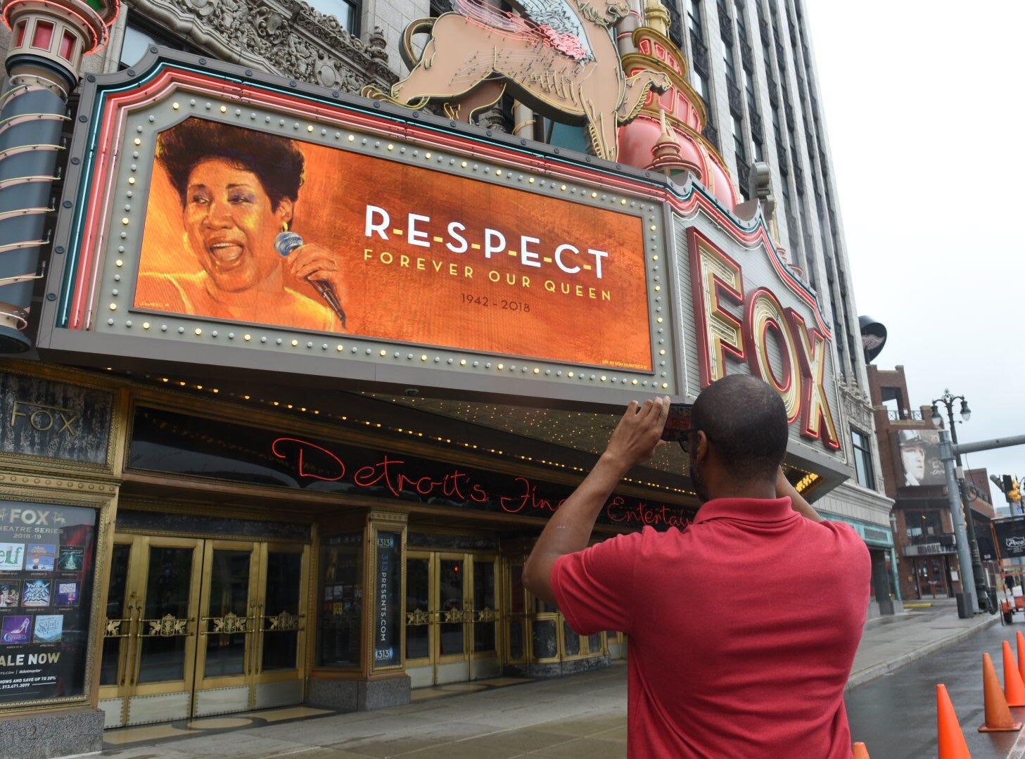 Robert Farnette of Detroit photographs a tribute to Aretha Franklin at the Fox Theatre on Thursday in Detroit.