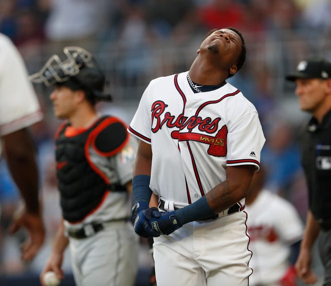 Atlanta Braves left fielder Ronald Acuna Jr. (13) reacts after being hit by a pitch from Miami Marlins starting pitcher Jose Urena in the first inning on Wednesday.