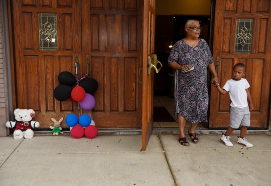 Shelia Laughlin, 58, of Detroit leaves New Bethel Baptist Church with her grandson, Khailon Turner, 5, after dropping off an obituary card for the late Aretha Franklin on Thursday, Aug. 16, 2018, in Detroit.