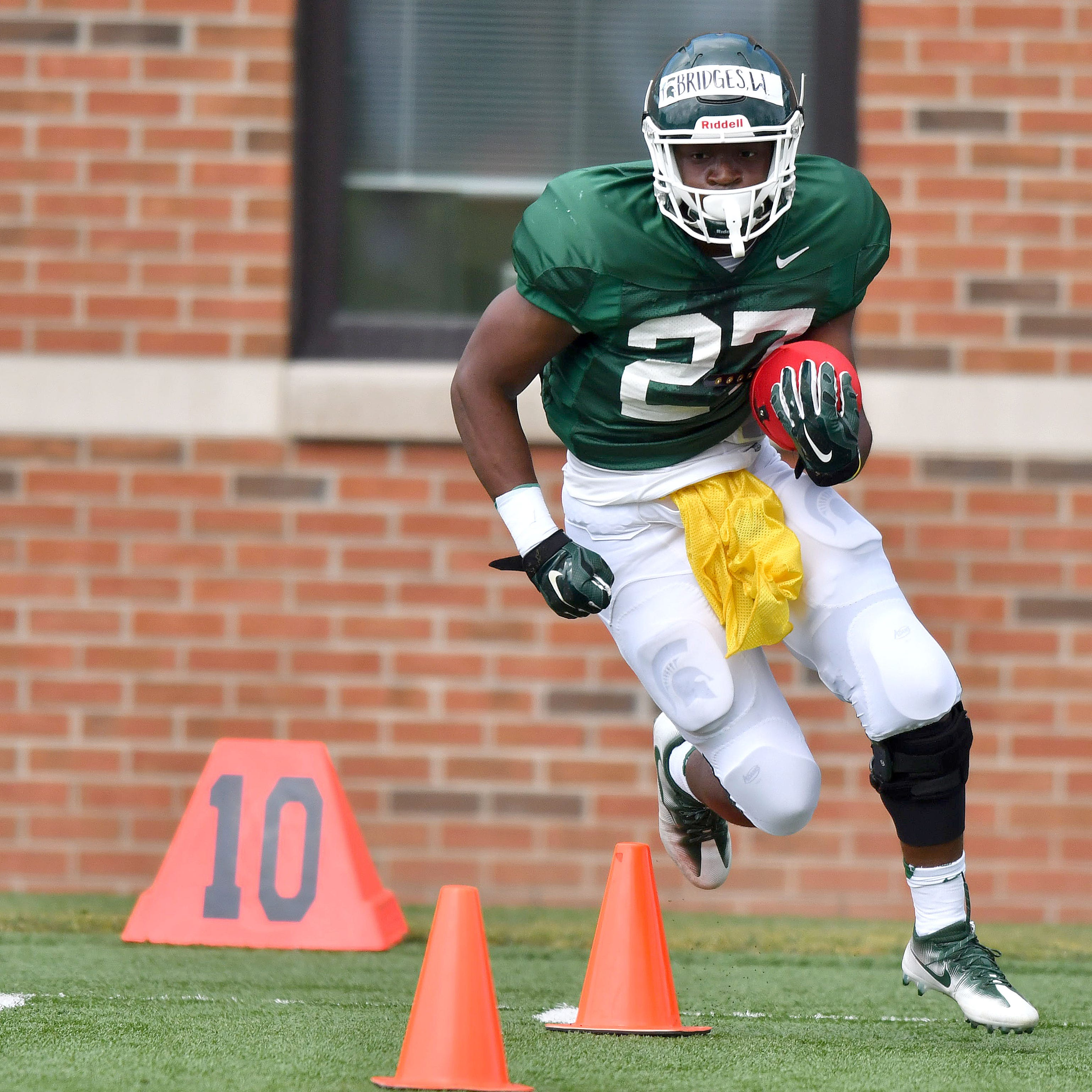 Michigan State's Weston Bridges rekindles love for football following ACL injuries