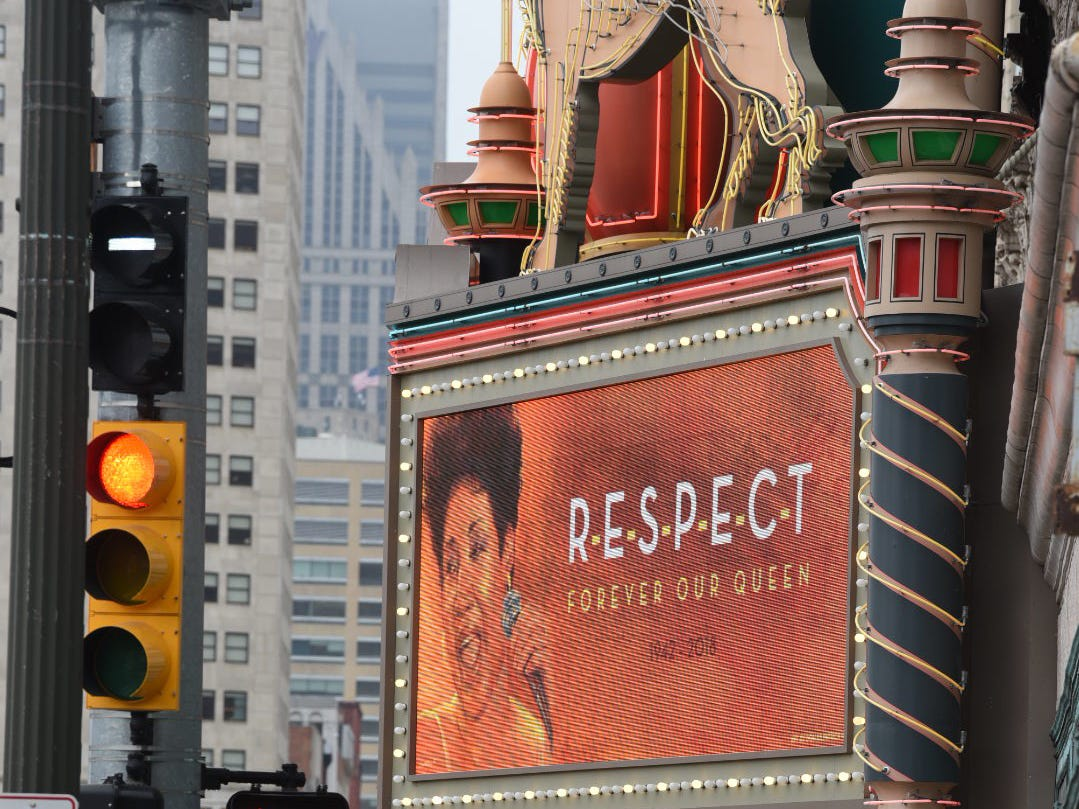 People pass a tribute to Detroit's Aretha Franklin at the Fox Theatre along Woodward on Thursday.