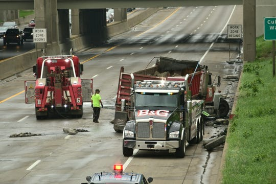 Emergency crews respond to a gravel hauler that rolled across I-75 near I-94 eventually coming to a stop in the southbound lanes, in Detroit, August 16, 2018.