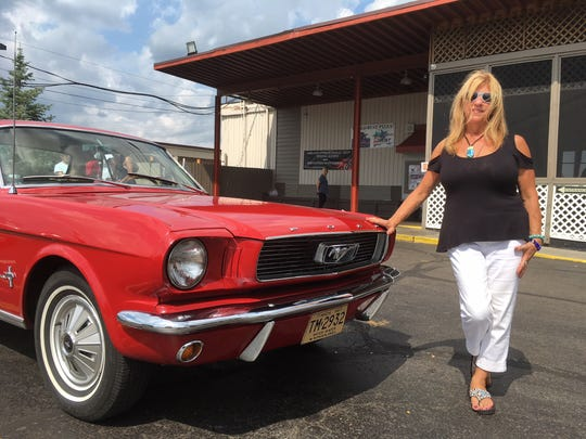 No one wants to see the engine of a 2012 Fusion, but a '66 Mustang attracts the curious. Unfortunately, a cruise fan didn't close Carol Walsh's hood correctly, and the hinges bent when it flew up while she was driving home.