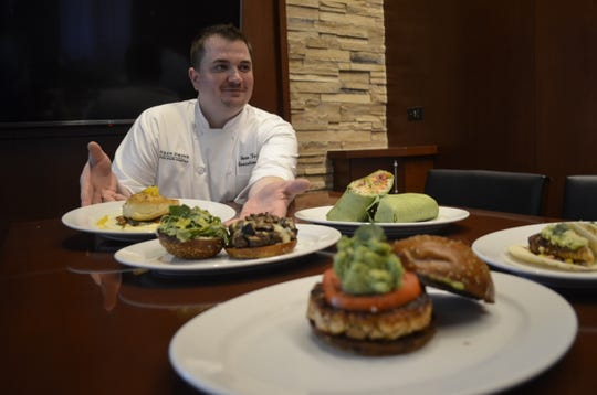 Ocean Prime executive chef, Sean Force, tastes new menu items.