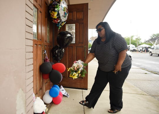 Carolyn Thompson of Detroit leaves a bouquet of flowers for Aretha Franklin at New Bethel Baptist Church in Detroit on Thursday, Aug. 16, 2018.