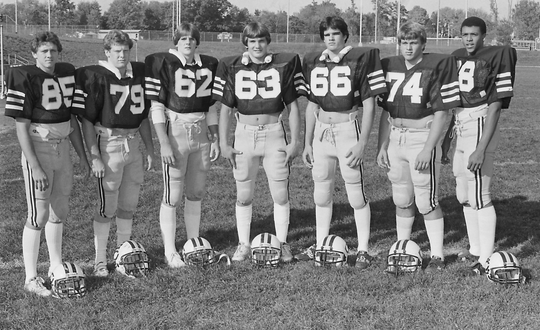 Pat Lockyear (63) was among Castle's standout linemen from its 1982 Class 3A state championship team. Deon Chester (far right) later played wide receiver for Ball State.