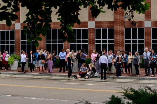 People congregate in front of Old National Events Plaza in Downtown Evansville after being evacuated from the Civic Center due to a possible gas leak, Thursday afternoon. Investigators found the reported smell was cleaning chemicals, not natural gas, and allowed everyone to go back inside the building within 15 minutes of the initial evacuation.