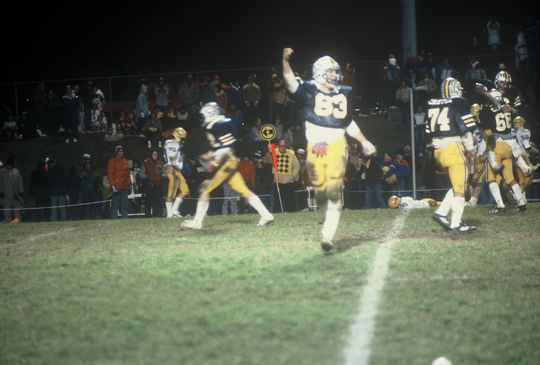 Castle's Pat Lockyear (63) celebrates a Knights touchdown against Carmel in the 1982 Class 3A semistate.