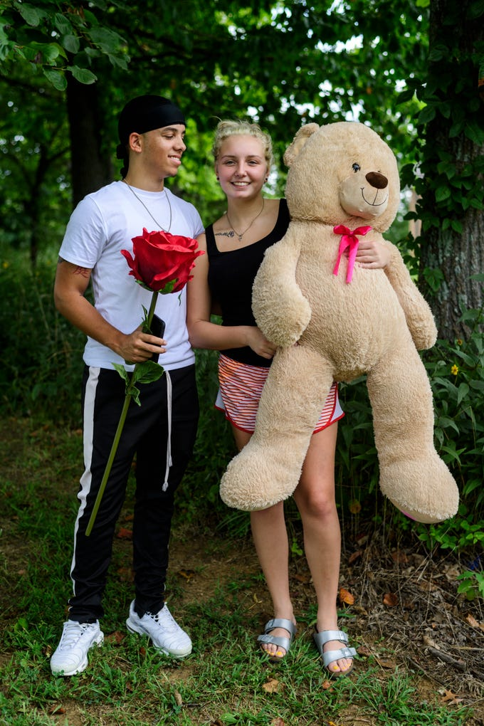 """Haley Barnes of Muncie, Ind., right, is a University of Southern Indiana freshman majoring in dental hygiene. She stands with her boyfriend, Jamaur Davis, left, who gave her a giant stuffed Teddy Bear and large plush rose last Valentine's Day. """"He's going into the Air Force soon, and I have to have a piece of him with me so I brought it,"""" Barnes said."""