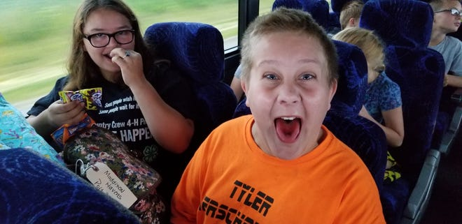Two youths on the Camp NEOSA bus trip share their excitement.
